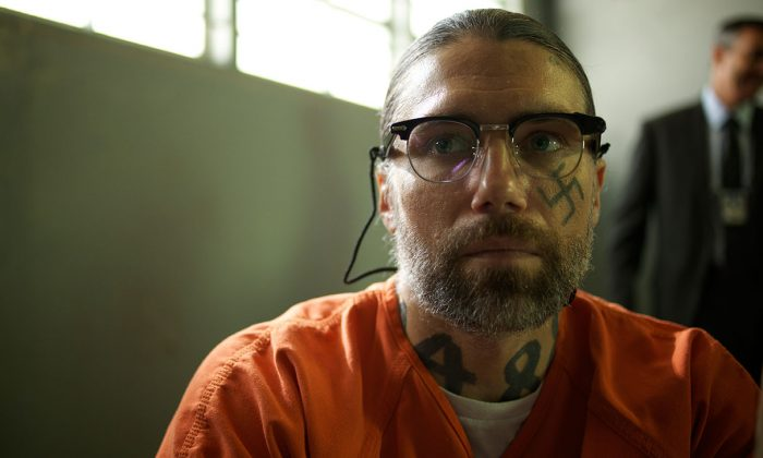 Aryan Brotherhood leader Sobecki (Anson Mount) being interrogated in prison. (Well Go USA)
