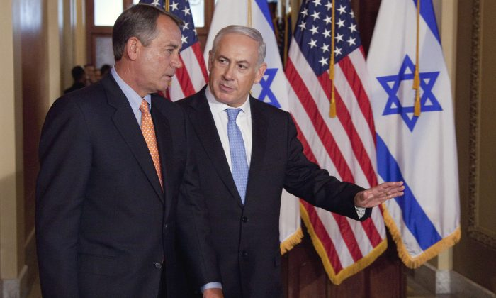 Israeli Prime Minister Benjamin Netanyahu (R) walks with House Speaker John Boehner of Ohio to make a statement on Capitol Hill in Washington on May 24, 2011. Boehner has invited Netanyahu to address Congress about Iran. (AP Photo/Evan Vucci)