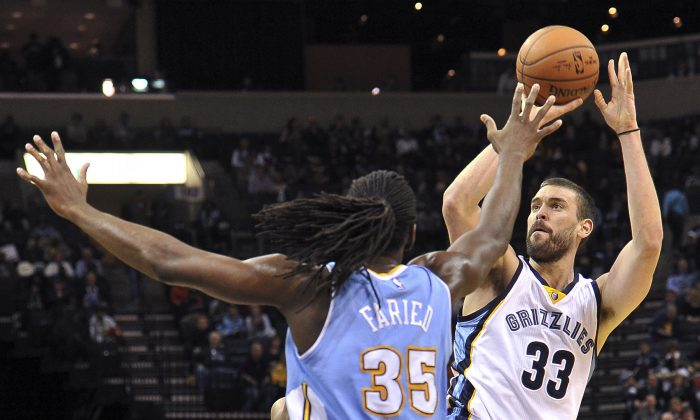Memphis Grizzlies center Marc Gasol (33) shoots against Denver Nuggets forward Kenneth Faried (35) during the second half of an NBA basketball game Thursday, Jan. 29, 2015, in Memphis, Tenn. (AP Photo/Brandon Dill)