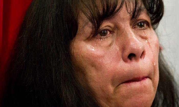Michele Pineault, whose daughter Stephanie Lane was murdered by serial killer Robert Pickton, cries during a news conference in Vancouver, March 29, 2012. Pineault says new evidence should prompt another murder charge against the serial killer. (The Canadian Press/Darryl Dyck)