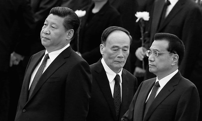 "Communist Party general secretary Xi Jinping (L), Premier Li Keqiang (R), and disciplinary  agency boss Wang Qishan (C), in Beijing, on Sept. 30, 2014. Growing numbers of Chinese officials have perished of ""unnatural causes,"" including suicide, since Xi Jinping took power in late 2012. (Feng Li/Getty Images)"