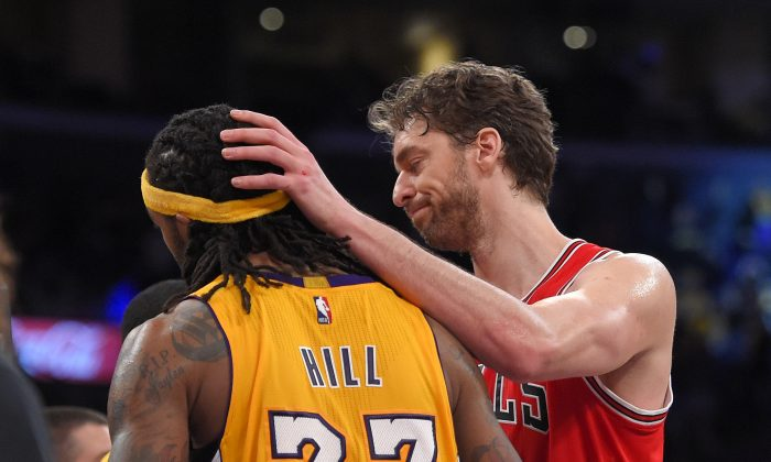 Chicago Bulls forward Pau Gasol, of Spain, pats Los Angeles Lakers center Jordan Hill on the head after the Lakers defeated the Bulls in double overtime of an NBA basketball game, Thursday, Jan. 29, 2015, in Los Angeles. The Lakers won 123-118. (AP Photo/Mark J. Terrill)