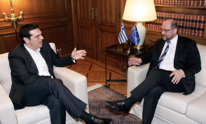 Greek Prime Minister Alexis Tsipras (L) holds a meeting with European Parliament President Martin Schulz at his office in central Athens on Jan. 29, 2015. (Milos Bicanski/Getty Images)