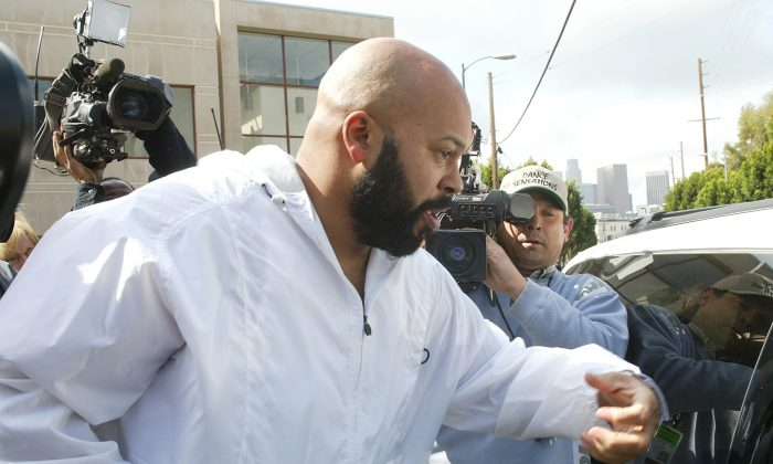 "Rap mogul Marion ""Suge' Knight leaving the Los Angeles County jail, in Los Angeles, Calif., on Wednesday, Feb. 26, 2003.  (AP Photo/Damian Dovarganes)"