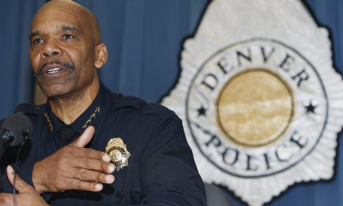 Denver Police Department Chief Robert White responds to questions during a news conference in Denver,  Jan. 29, 2015. He has faced calls for his resignation after vandals defaced a police memorial on Saturday.  (AP Photo/David Zalubowski)