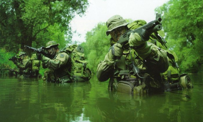 Soldiers screening swampy jungle area