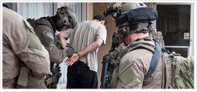 FBI SWAT team making an arrest. (Courtesy FBI)