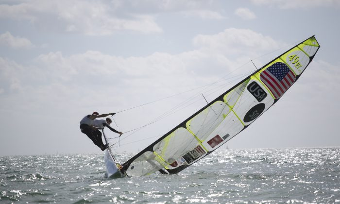 FEB 1: United States teammates Brad Funk and Trevor Burd try to keep their 49ers class boat upright during the ISAF Sailing World Cup on Biscayne Bay, Miami, on Jan. 31, 2015. (AP Photo/J Pat Carter)