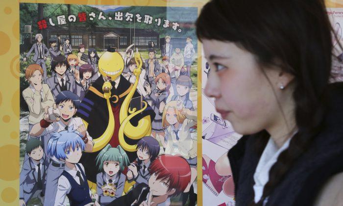 "A woman walks past a poster of animation ""Assassination Classroom"" in Tokyo, Saturday, Jan. 31, 2015. (AP Photo/Koji Sasahara)"