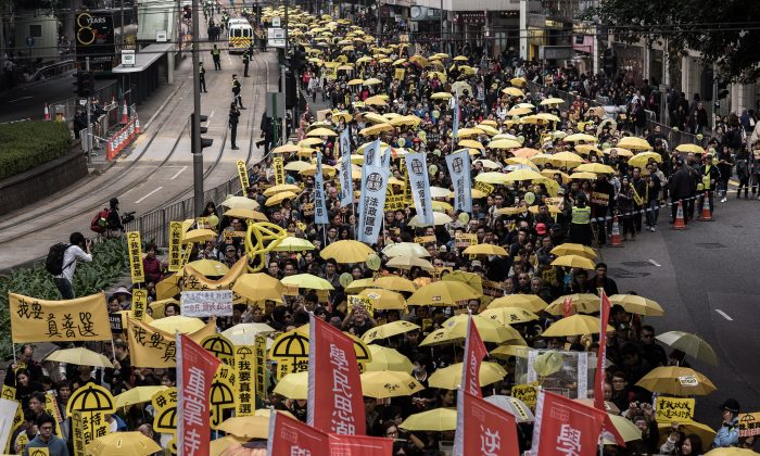 Demonstrators march for democracy in Hong Kong on Feb. 1, 2015. (Philippe Lopez/AFP/Getty Images)