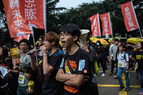 Joshua Wong, student leader, shouts as tens of thousands of protesters called for real universal suffrage during a march for democracy on Feb. 1, 2015 in Hong Kong. (Lam Yik Fei/Getty Images)