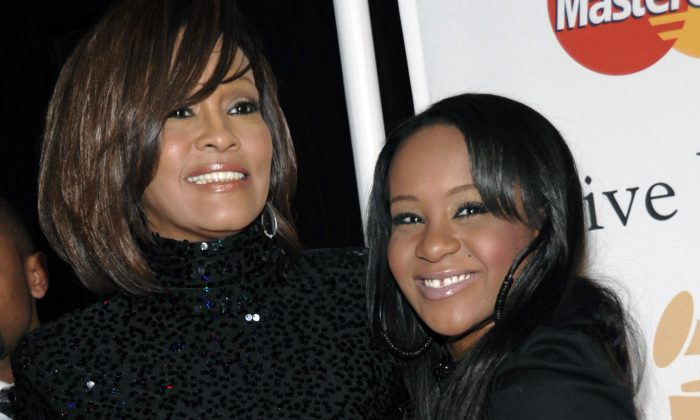In this Feb. 12, 2011, file photo, singer Whitney Houston, left, and daughter Bobbi Kristina Brown arrive at an event in Beverly Hills, Calif.  (AP Photo/Dan Steinberg)