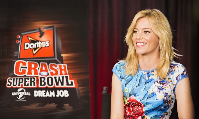 """Actress Elizabeth Banks helps the Doritos brand kick-off the ninth installment of the Crash the Super Bowl contest, on Wed., Sept. 3, 2014 in Los Angeles. Fans from participating countries around the world are invited to enter their homemade 30-second Doritos ads as part of this year's competition for the chance to see those ads air during the Super Bowl broadcast. One lucky fan – based on consumer votes - will win the grand prize: a """"dream"""" job working onsite at Universal Pictures in Hollywood and $1 million. See full rules and enter at Doritos.com between September 12 and November 9. (Photo by Colin Young-Wolff/Invision for Doritos/AP Images)"""