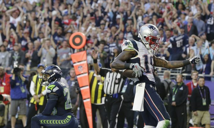 New England Patriots wide receiver Brandon LaFell (19) celebrates after catching an 11-yard touchdown pass in front of Seattle Seahawks free safety Earl Thomas (29) during the first half of NFL Super Bowl XLIX football game Sunday, Feb. 1, 2015, in Glendale, Ariz. (AP Photo/Matt Rourke)