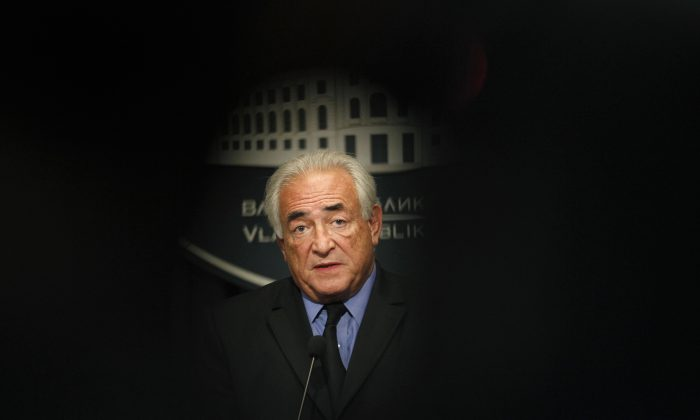 Ex-IMF chief Dominique Strauss-Kahn speaks during a press conference after his meeting with Serbia's deputy PM Aleksandar Vucic in Belgrade, Serbia, on Sept. 17, 2013. The French economist known universally by his initials DSK faces up to 10 years in prison and a 1.5 million euro ($1.7 million) fine on charges of aggravated pimping, along with over a dozen other French and Belgian businessmen and police officers at the trial beginning Monday at a courthouse in the northern French city of Lille. (AP Photo/Darko Vojinovic)