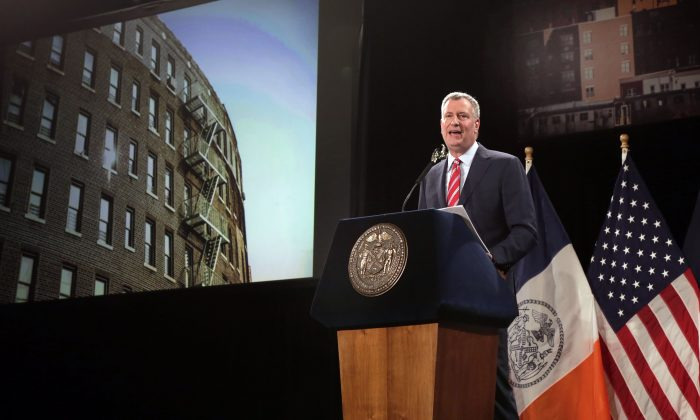New York Mayor Bill de Blasio delivers his State of the City address at Baruch College, in New York, Tuesday, Feb. 3, 2015. He detailed his ambitious plans to build and preserve affordable housing throughout New York City. (AP Photo/Richard Drew)