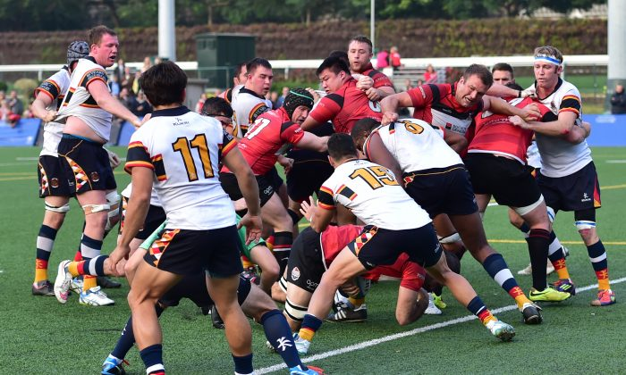 Thomas Lamboley of Valley RFC crosses the HKCC tryline in their HKRFU Premiership match on Saturday Jan 31, 2015 but the score did not count as he was adjudged to have knocked-on. HKCC won the match 12-7 in a tight and exciting second-half play. (Bill Cox/Epoch Times)