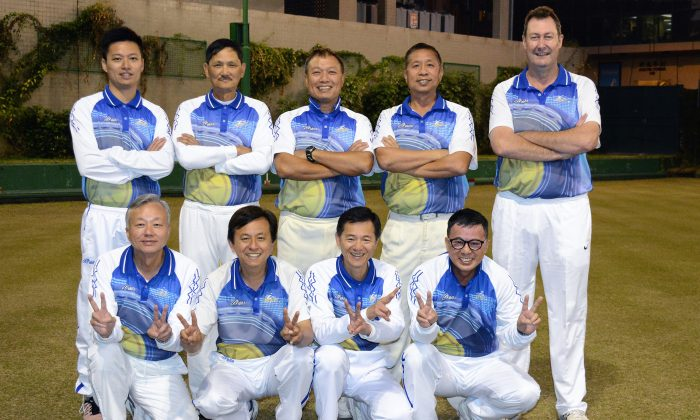 A jubilant Police team celebrates their first ever Triples League title, after defeating a strong Kowloon Bowling Green Club side away from home on Saturday Jan 31, 2015.(Stephanie Worth)