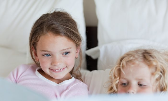 Parental limits on the use of electronics, including not looking at screens before bed, helps children get better rest. (Wavebreakmedia Ltd/Wavebreakmedia Media/Thinkstock)