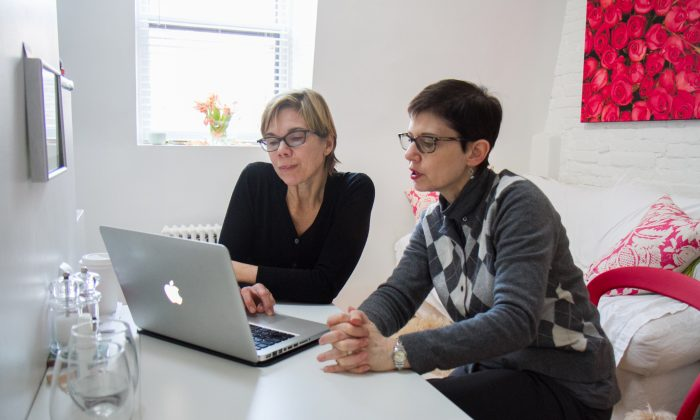 Liz Gessner (L) organizes her tax documents with professional organizer Sharon Lowenheimat at Gessner's home in Park Slope, Brooklyn, on Jan. 22. As life gets more complicated, more people are hiring professional organizers for various aspects of life. (Amelia Pang/Epoch Times)