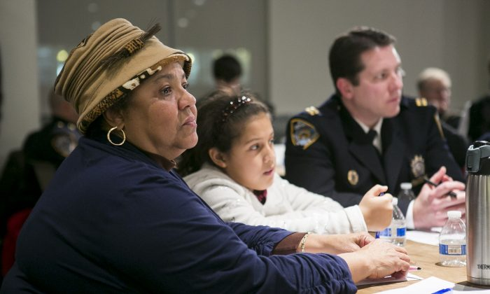 The Rev. Georgette Morgan-Thomas moderates a discussion at her roundtable on how to improve police–community relations, in Washington Heights, Manhattan, on Feb. 2. To her left is Capt. Michael Baker, whom she works closely with. (Samira Bouaou/Epoch Times)