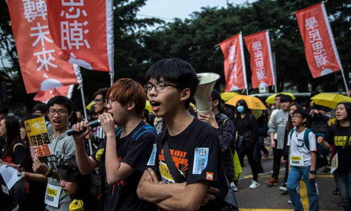 Joshua Wong, student leader, shouts during tens of thousands of protesters march for the real universal suffrage on Feb. 1, 2015 in Hong Kong. (Lam Yik Fei/Getty Images)