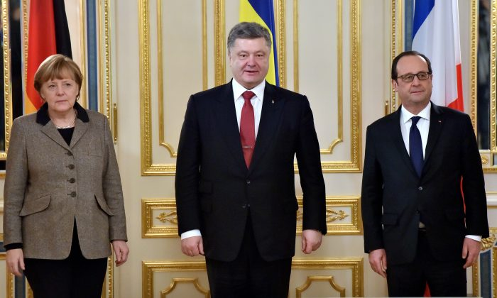 (L-R) German Chancellor Angela Merkel, Ukrainian President Petro Poroshenko, and French President Francois Hollande pose for the media prior to their meeting in Kiev on Feb. 5, 2015. Angela Merkel and Francois Hollande touched down in Kiev on Feb. 5 with a new peace plan to stop an upsurge in fighting in east Ukraine. (Sergei Supinsky/AFP/Getty Images)