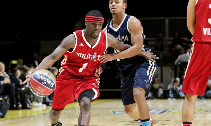Comedian Kevin Hart (L) and Romeo Miller participate in the NBA All-Star Celebrity Game 2014 at New Orleans Arena on February 14, 2014 in New Orleans, Louisiana.  (Photo by Leon Bennett/Getty Images)