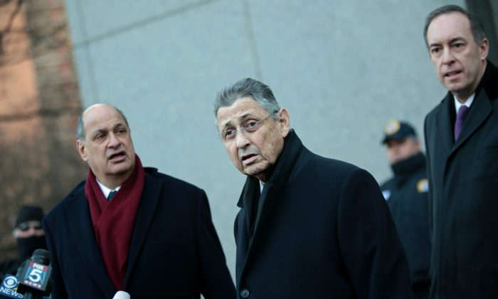 New York State Assembly Speaker Sheldon Silver (C) walks out of the Federal Courthouse in New York after his arraignment on Jan. 22, 2015. (Yana Paskova/Getty Images)
