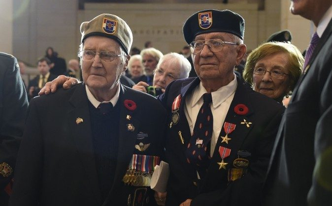 Canadian veteran Charles Mann (L) and U.S. veteran Eugene Gutierrez stand following the presentation of the Congressional Gold Medal during a ceremony on Capitol Hill in Washington on Feb. 3, 2015. The award was given to the surviving members of the First Special Service Force, aka the Devil's Brigade, whose fearlessness and bravery contributed to the liberation of Europe and the end of World War II. (AP Photo/Susan Walsh)