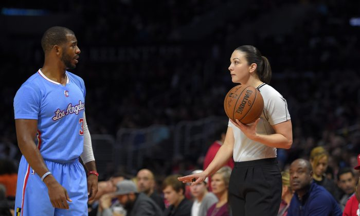 Los Angeles Clippers guard Chris Paul, left, talks with referee Lauren Holtkamp during the first half of an NBA basketball game against the Miami Heat, Sunday, Jan. 11, 2015, in Los Angeles. (AP Photo/Mark J. Terrill)