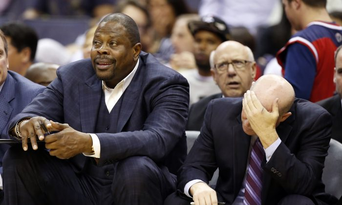Charlotte Hornets assistant head coach Patrick Ewing, left, sits on the bench with head coach Steve Clifford, in the second half of a pre-season NBA basketball game against the Washington Wizards, Friday, Oct. 17, 2014 in Washington. The Hornets won 96-86. (AP Photo/Alex Brandon)