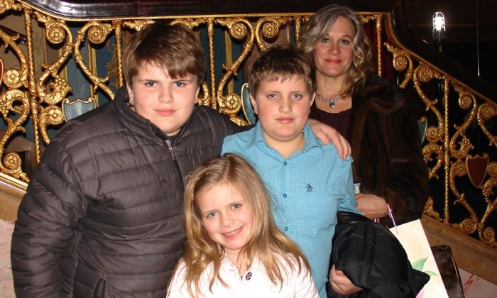 The Godraili family enjoyed Shen Yun Performing Arts at the Detroit Opera House, on Feb. 6, 2015. (Ying Wan/Epoch Times)
