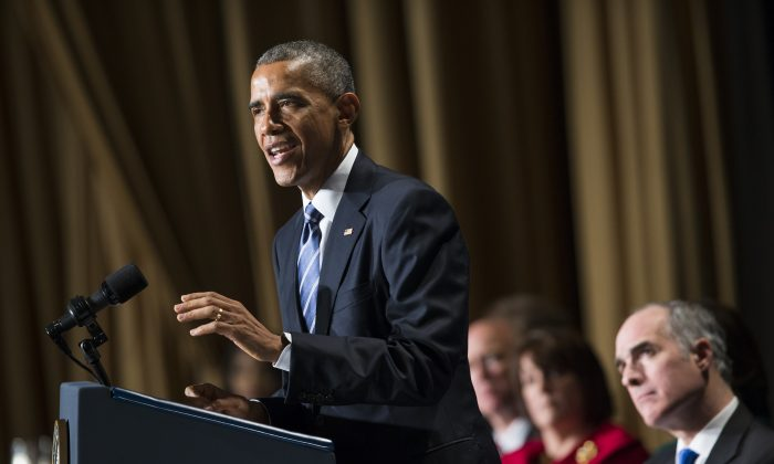 """President Barack Obama speaks during the National Prayer Breakfast in Washington, Feb. 5, 2015. The president condemned those who seek to use religion as a rationale for carrying out violence around the world, declaring Thursday that """"no god condones terror."""" (AP Photo/Evan Vucci)"""