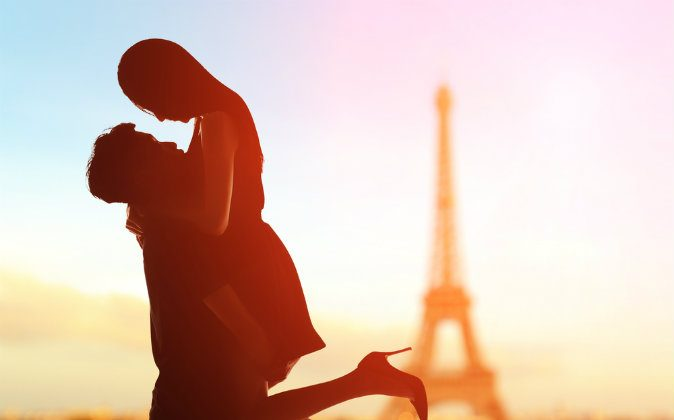 A silhouette of romantic lovers with eiffel tower in Paris via Shutterstock*
