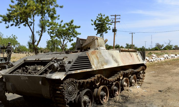 This picture taken on November 12, 2014 in front of the military base of Amchide, northern Cameroon, 1 km from Nigeria, shows a Boko Haram tank destroyed by Cameroonian soldiers during an attack against the military base by the Islamic fighters on October 15, 2014. (Reinnier Kaze/AFP/Getty Images)