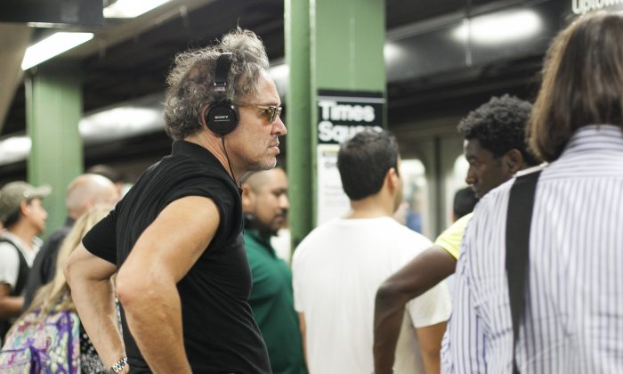 Commuters wait on the platform at the Times Square subway station in Manhattan, New York, August 27, 2014. (Samira Bouaou/Epoch Times)