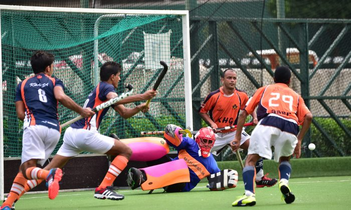 SSSC-A (in orange and black strip) defending against Khalsa-A in the final of the Guru Nanak Tournament on Nov 30, 2014. (Bill Cox/Epoch Times)