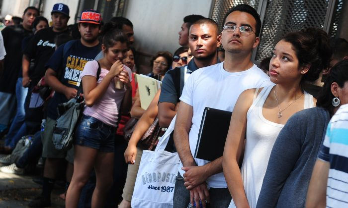 Young people wait in line to enter the office of The Coalition for Humane Immigrant Rights in Los Angeles on Aug. 15, 2012. (Frederic J. Brown/AFP/GettyImages)