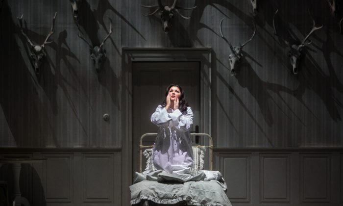 """Anna Netrebko in the title role of Tchaikovsky's """"Iolanta."""" This moving fairy tale might be better supported with a less gloomy set design. (Marty Sohl/Metropolitan Opera)"""