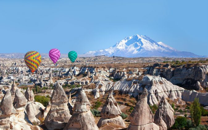 Hot air balloons flying over Cappadocia via Shutterstock*