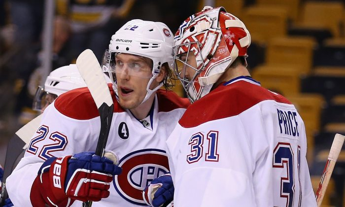 Montreal's Dale Weise congratulates Carey Price after the game against the Boston Bruins at TD Garden on Feb. 8, 2015 in Boston. (Maddie Meyer/Getty Images)