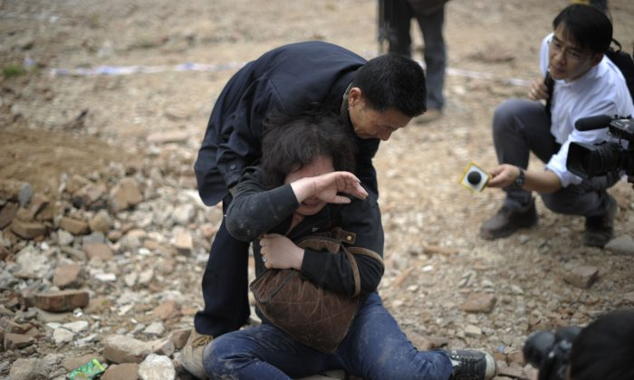 A homeowner who failed to protect her home from demolition in Guangzhou, in south China's Guangdong Province on March 21, 2012. Real estate companies work hand-in-glove with corrupt officials in order to get land cleared for development. (STR/AFP/Getty Images)