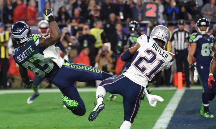 Malcolm Butler (R) of the New England Patriots intercepts a pass intended for Ricardo Lockette (L) of the Seattle Seahawks late in the fourth quarter of Super Bowl XLIX in Glendale, Ariz., on Feb. 1, 2015. (Timothy A. Clary/AFP/Getty Images)