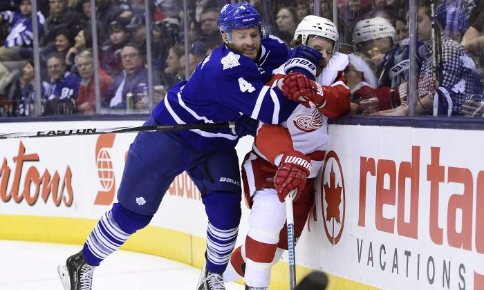 Toronto Maple Leafs' Cody Franson hits Detroit Red Wings' Justin Abdelkader at the Air Canada Centre in Toronto on Nov. 22, 2014. (The Canadian Press/Frank Gunn)
