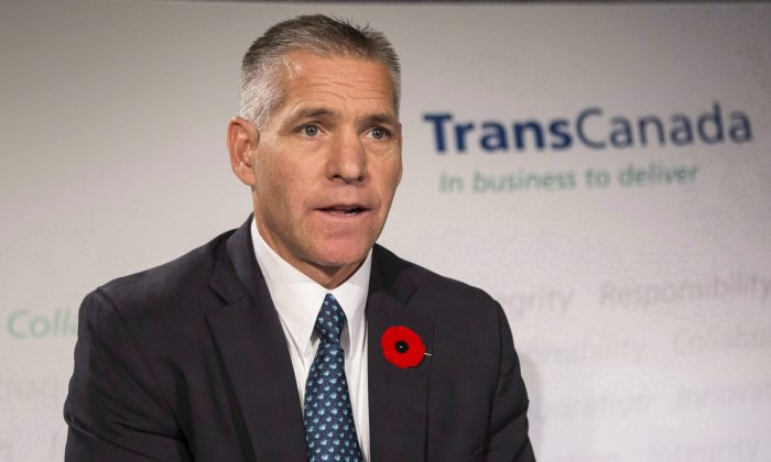 TransCanada CEO Russ Girling speaks at a news conference in Toronto on Oct. 30, 2014. Girling says he deosn't agree with the U.S. Environmental Protection Agency's view that the Keystone XL pipeline's role in climate change must be reconsidered in light of the steep drop in crude prices. (The Canadian Press/Chris Young)