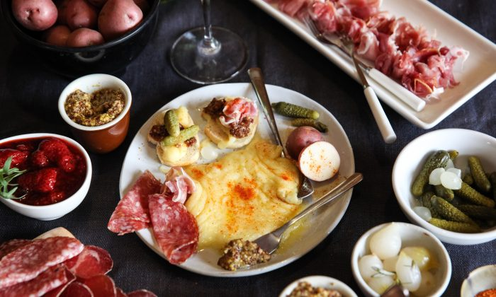 A plate of swiss raclette cheese surrounded by various cured meats, spreads, and breads. Had this course not been so good, perhaps I wouldn't have descended into food coma. (Deer Valley Resort)