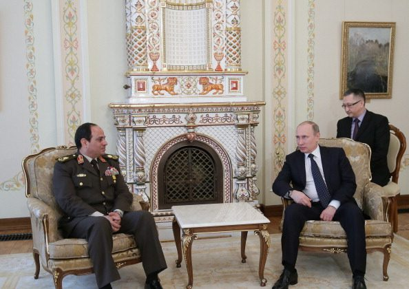 Egyptian army chief Abdel Fattah al-Sisi (L) speaks with Russian President Vladimir Putin during their meeting in Novo-Ogaryovo residence, outside Moscow, on February 13, 2014. (MIKHAIL METZEL/AFP/Getty Images)