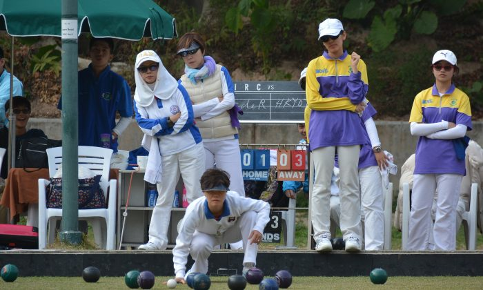 Tammy Tham (front) of Club de Recreio watching anxiously to a bowl delivered by her skip during the semi-final of the National Fours against the Hong Kong Youth Team at Indian Recreation Club on Sunday Feb 8, 2015. The CdeR team came from behind to beat the youngsters 22:20. (Stephanie Worth)