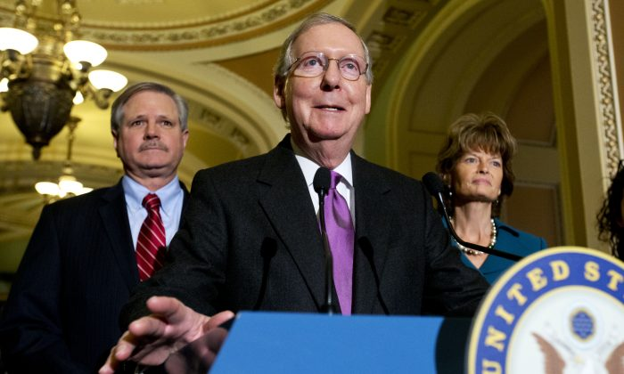 Senate Majority Leader Mitch McConnell of Ky., (C) speaks about Keystone XL with Sen. John Hoeven, R-N.D., (L) sponsor of the Keystone XL pipeline bill, and Sen. Lisa Murkowski, R-Alaska, in Washington, D.C., on Jan. 29, 2015. The Republican-controlled Congress passed a bill on Feb. 11, 2015 approving construction of the pipeline. (AP Photo/Jacquelyn Martin)